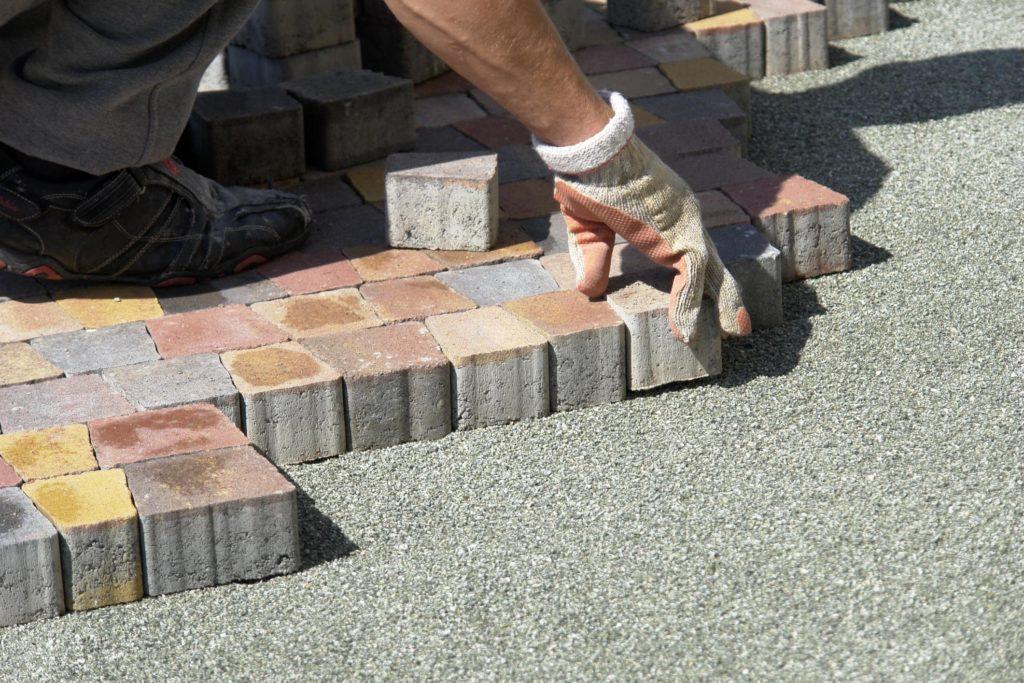 masonry concrete worker doing driveway